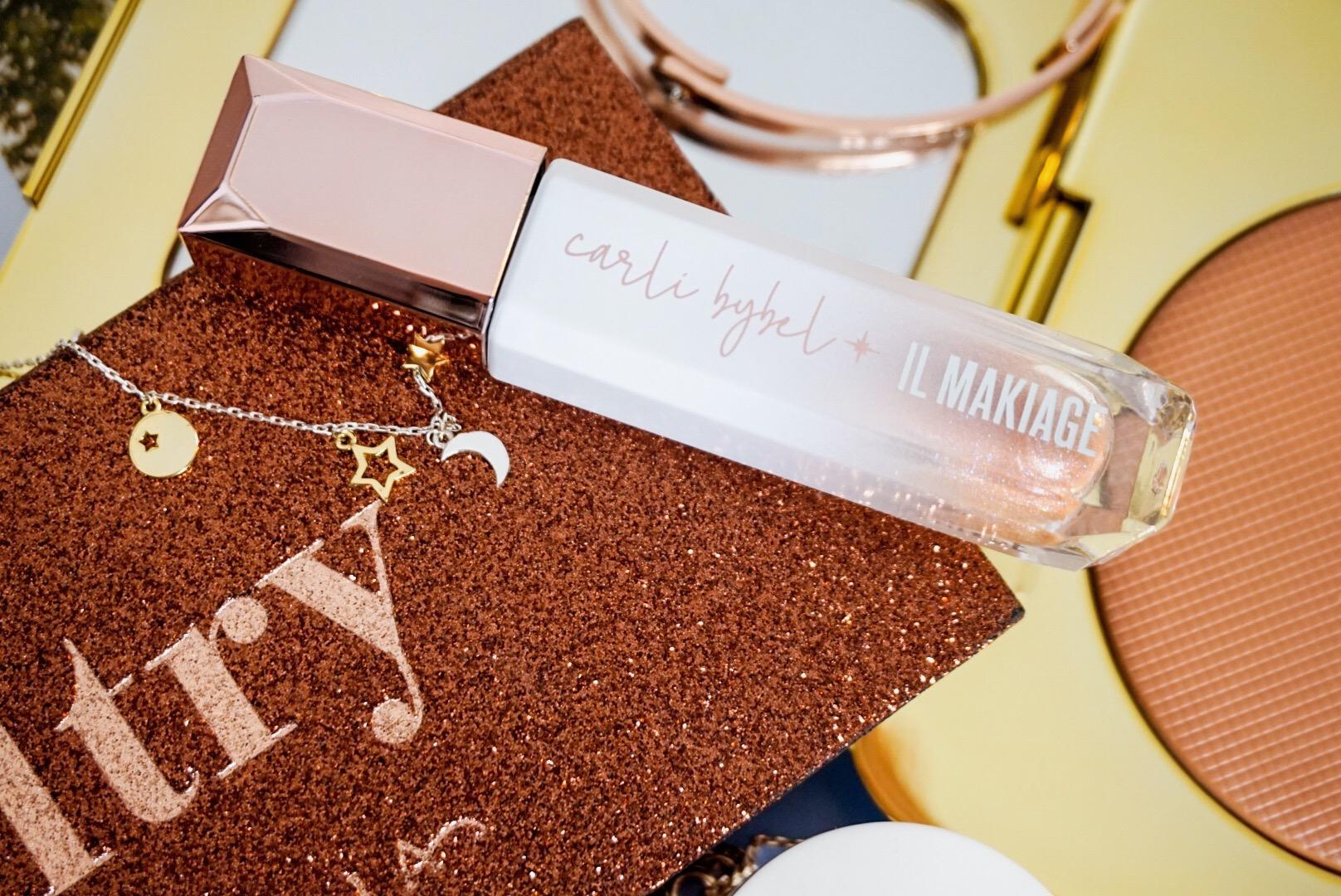 Yearlong Low Buy | Luxury Makeup Flatlay | Anastasia Beverly Hills, Estee Lauder, Il Makiage, JD Glow, Nars, Shiseido, Tom Ford | Il Makiage x Carli Bybel Hi-Shine Lip Glaze in Star Child
